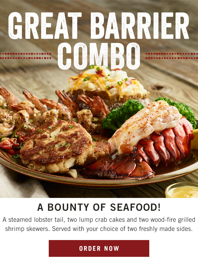 Great Barrier Combo - a bounty of seafood! A steamed lobster tail, two lump crab cakes and two wood-fire grilled shrimp skewers. Served with your choice of two freshly made sides.